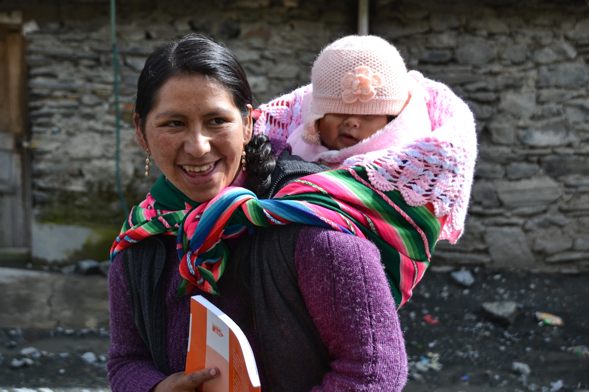 Bolivia - Aymara woman with baby on back-- 1200px