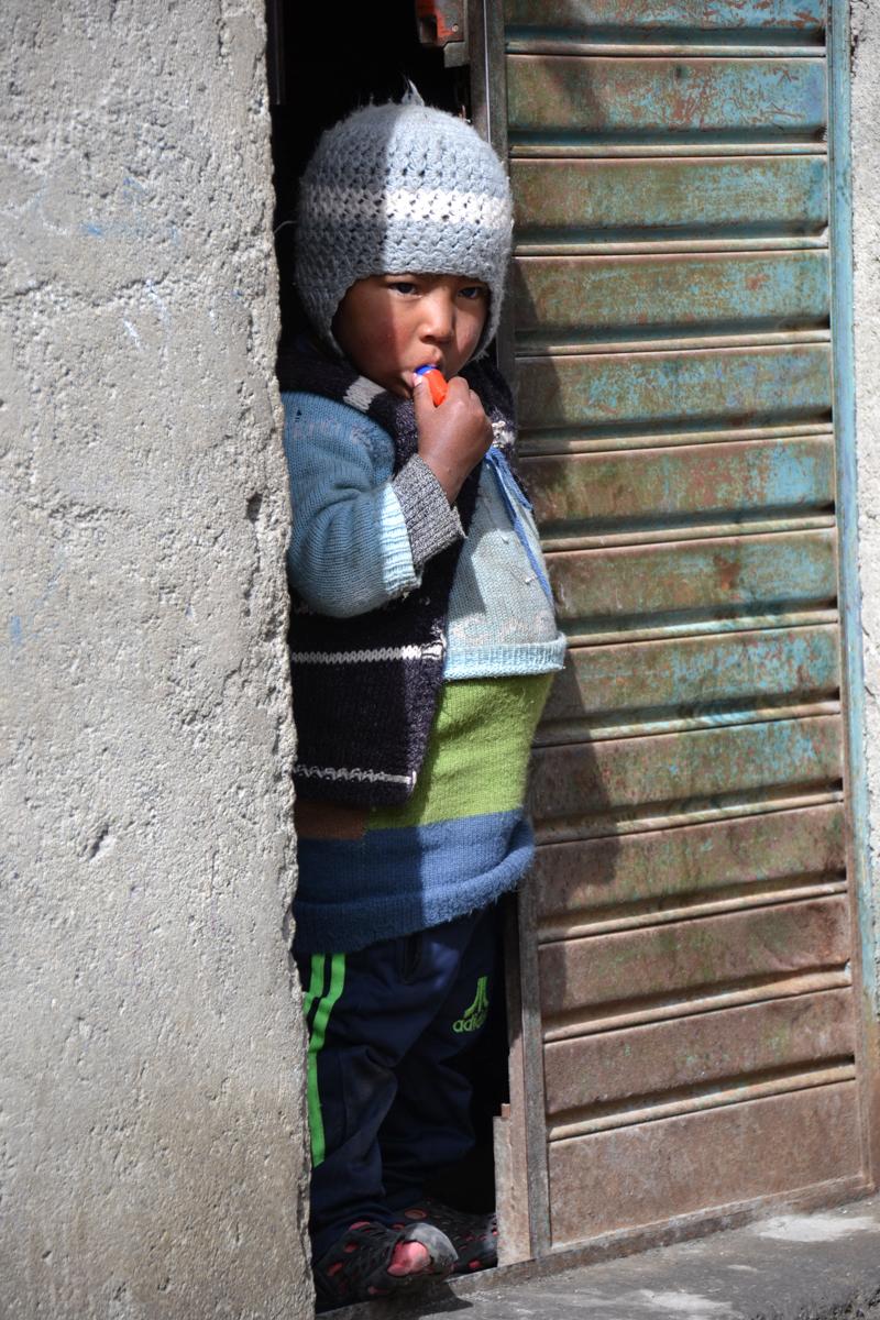 Bolivia - Boy in open door-- 1200px