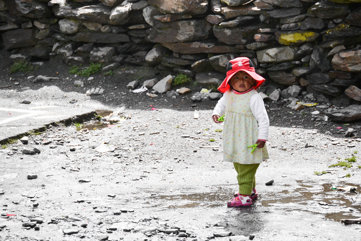 Bolivia - Girl with red hat in Agua Blanca-- 1200px