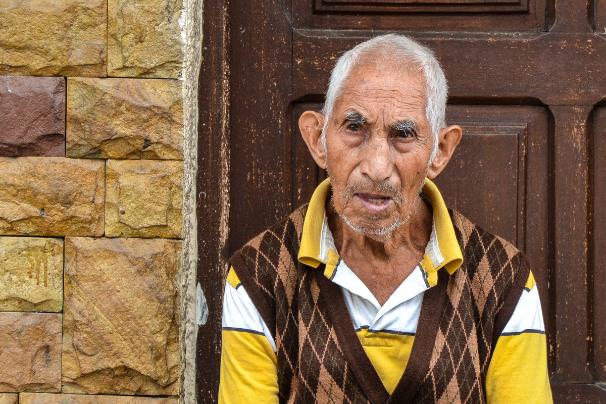 Bolivia - Old man yellow brown-- 1200px