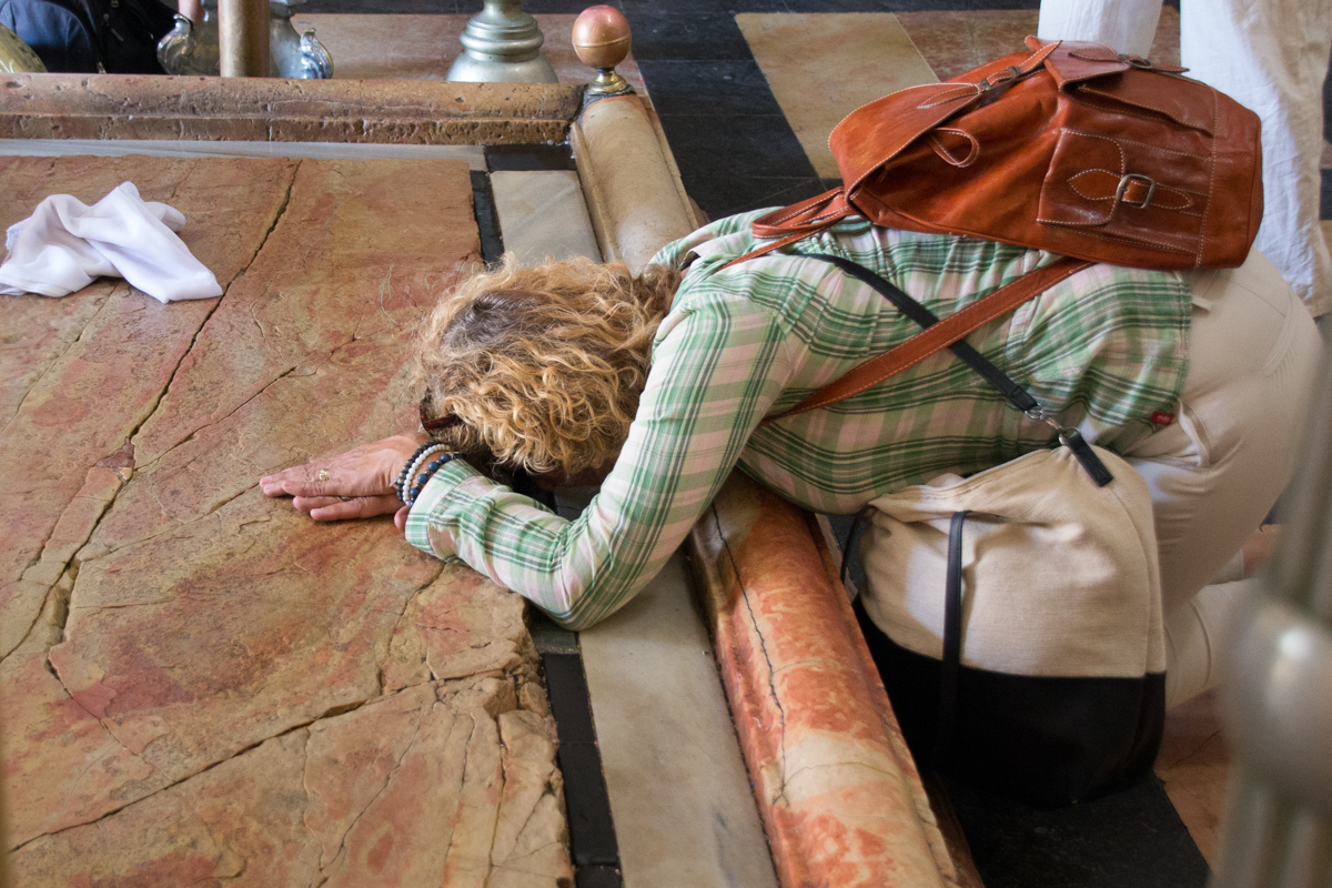 Israel - Praying woman in Church of holy sepulchre Jerusalem- 1200px
