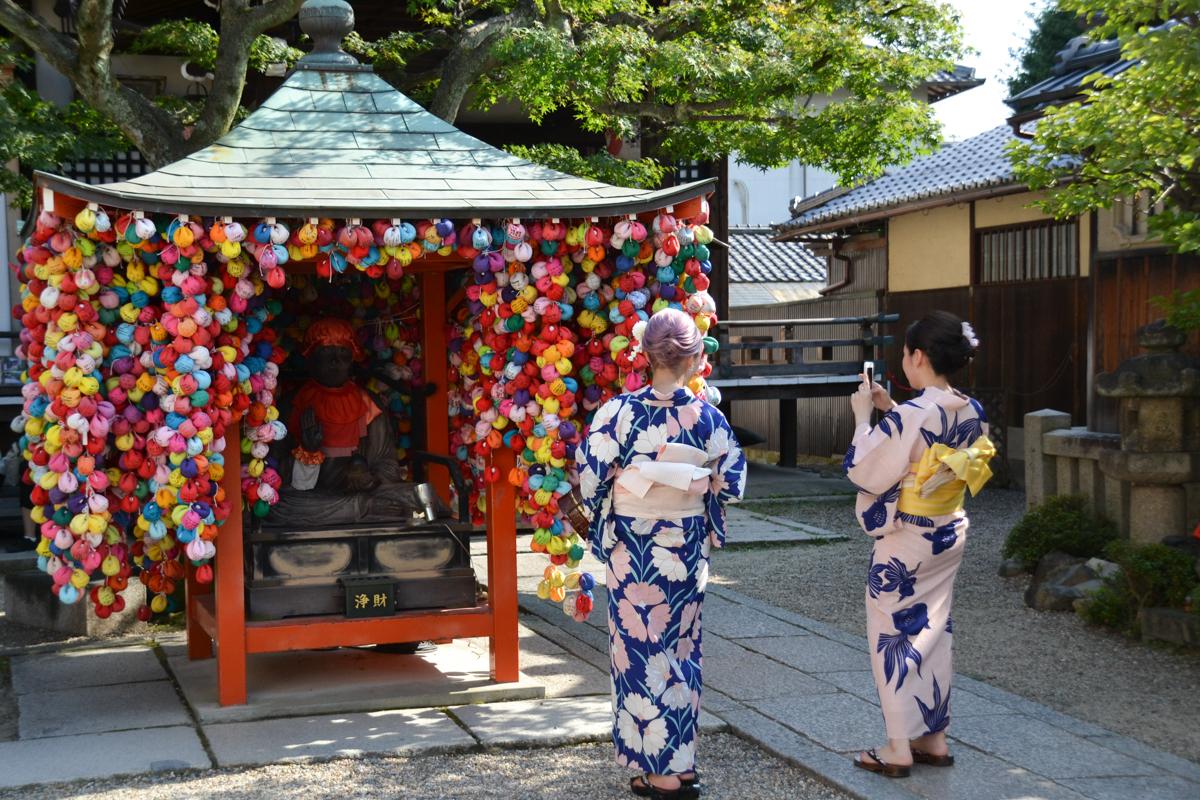 Japan - Ladies in kimono with Jizo Shrine