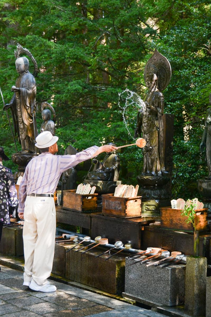 Japan - Man offering water