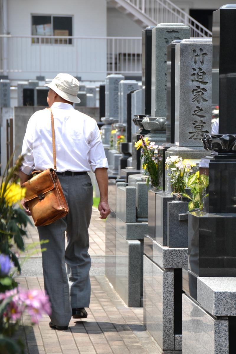 Japan - Man on cemetary