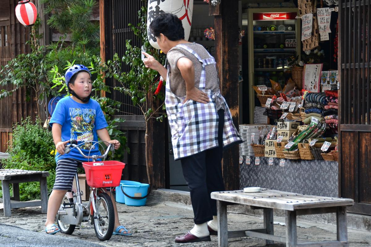Japan - Woman warning boy on bike